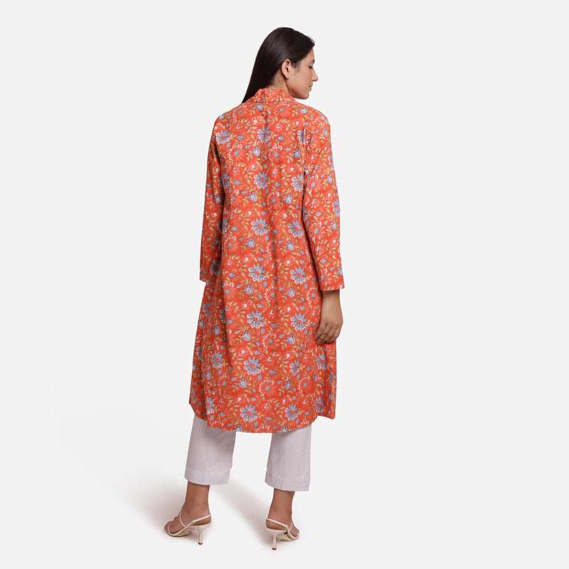 Back View of a Model wearing Orange Floral Knee Length Trench Coat