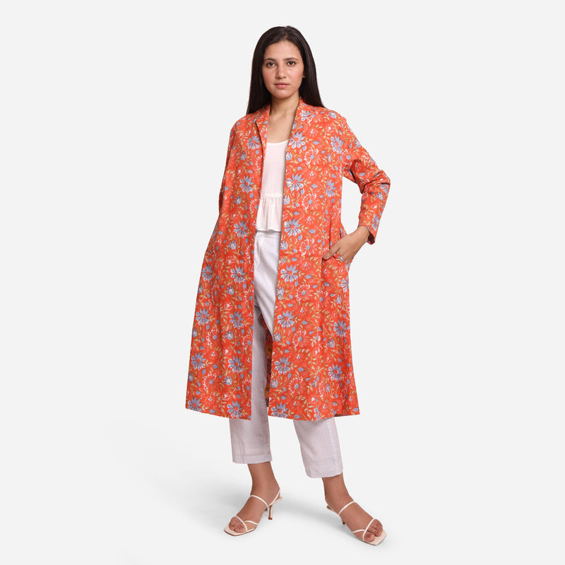 Front View of a Model wearing Orange Floral Knee Length Trench Coat