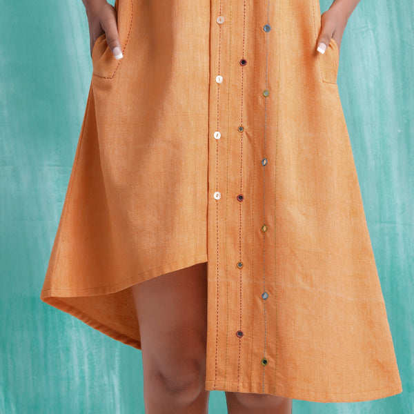 Close View of a Model wearing Orange Handspun Asymmetric Mirror Shirt Dress