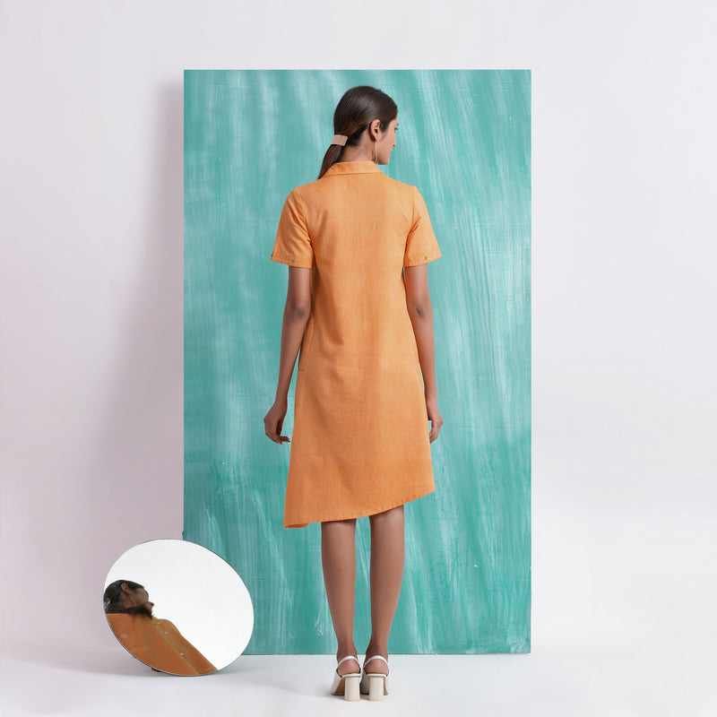Back View of a Model wearing Orange Mirrored Asymmetrical Shirt Dress