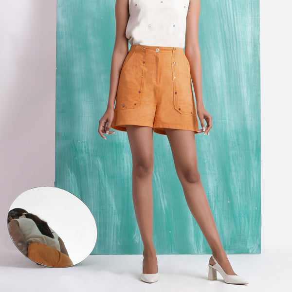 Front View of a Model wearing Orange Handspun Mirror Work Shorts