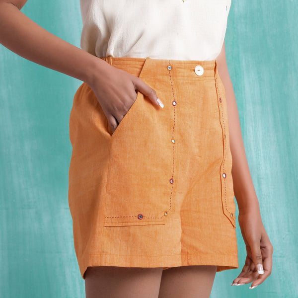 Right View of a Model wearing Orange Handspun Mirror Work Shorts