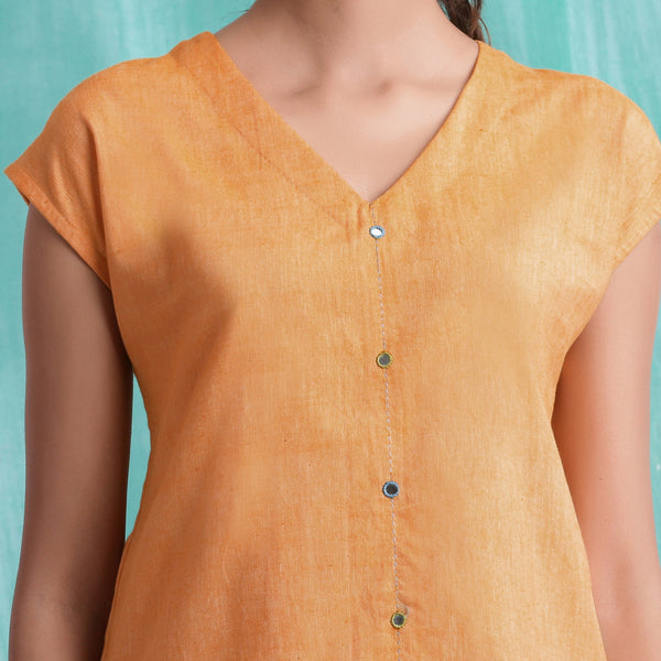 Front Detail of a Model wearing Orange Hand Mirror Work Drop Shoulder Top