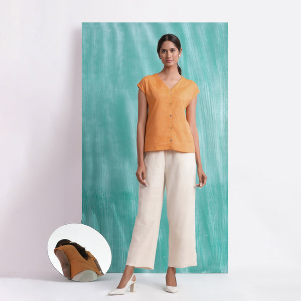 Front View of a Model wearing Orange Hand Mirror Work Drop Shoulder Top