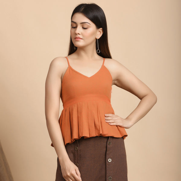 Front View of a Model wearing Orange Pleated Camisole Top