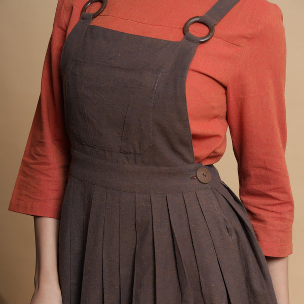 Front Detail of a Model wearing Orange Pleated Top and Brown Dress Set