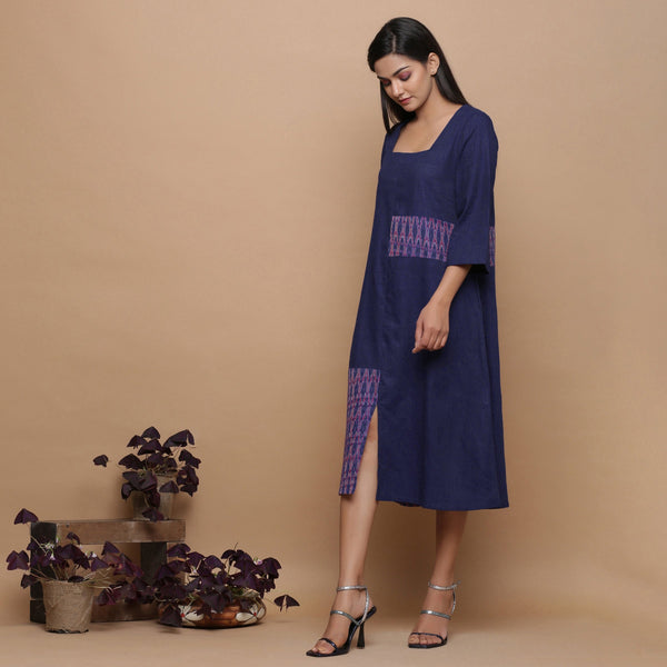 Left View of a Model wearing Paneled Ikat Blue Handspun Slit Dress