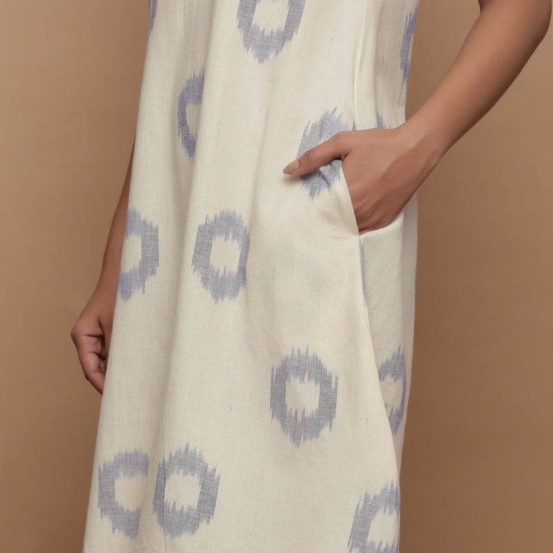 Left Detail of a Model wearing Off-White Paneled Sleeveless Cotton Dress