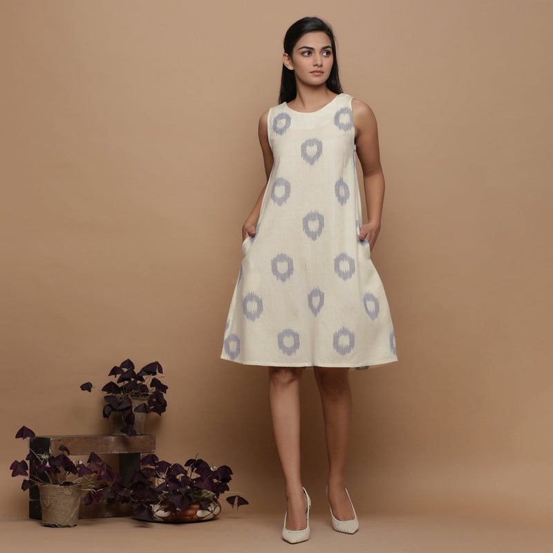 Front View of a Model wearing Off-White Paneled Sleeveless Cotton Dress
