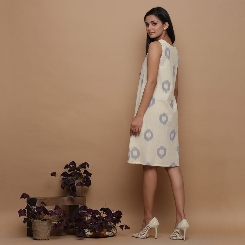 Back View of a Model wearing Off-White Paneled Sleeveless Cotton Dress