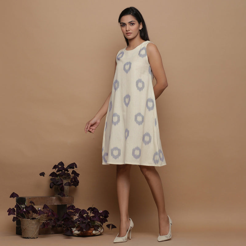 Left View of a Model wearing Off-White Paneled Sleeveless Cotton Dress