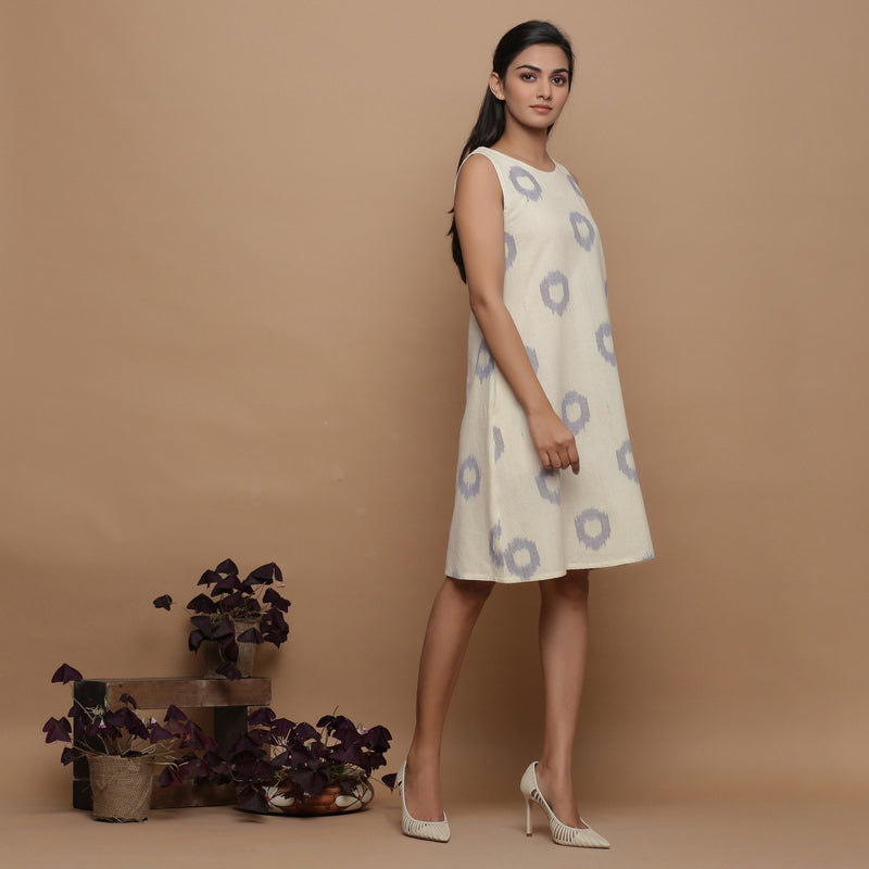 Right View of a Model wearing Off-White Paneled Sleeveless Cotton Dress