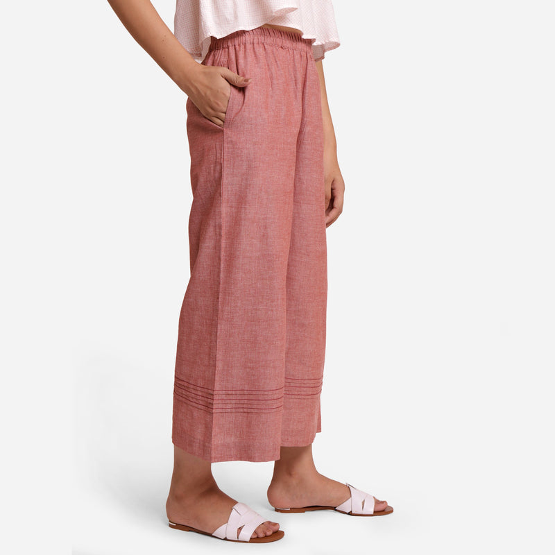 Right View of a Model wearing Peach Comfort-Fit Cotton Flared Pant