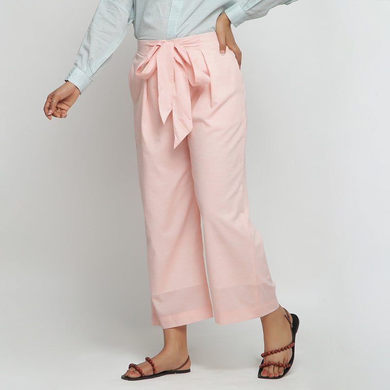 Left View of a Model wearing Peach Mid Rise Cotton Straight Pant