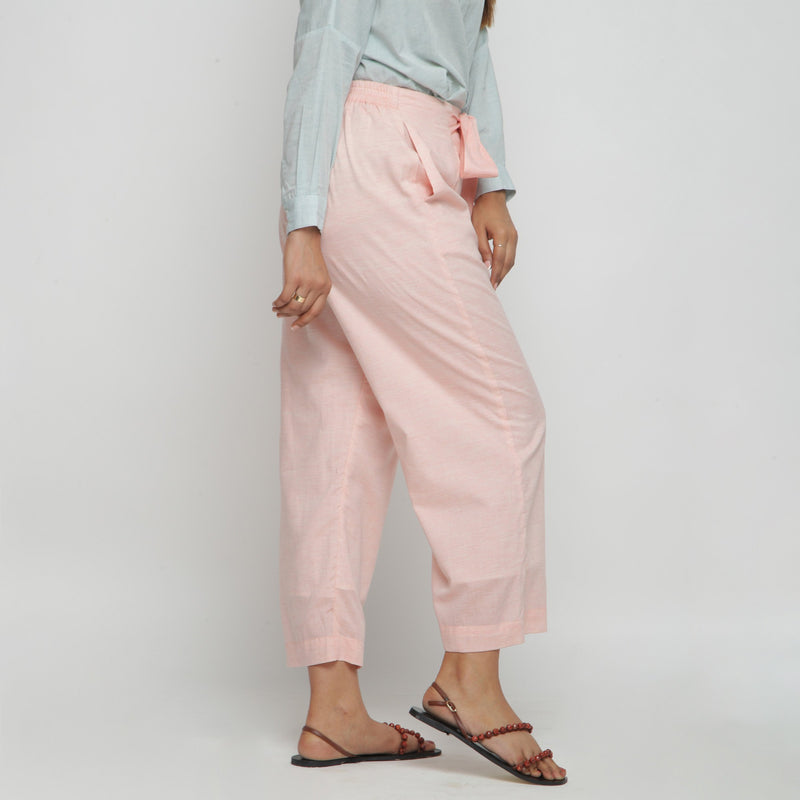 Right View of a Model wearing Peach Mid Rise Cotton Straight Pant