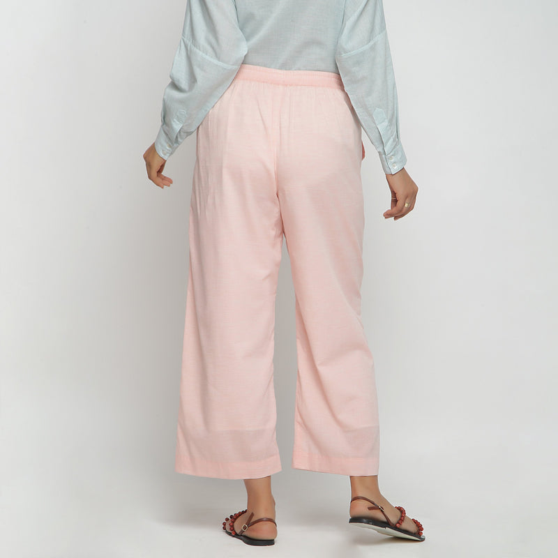 Back View of a Model wearing Peach Mid Rise Cotton Straight Pant