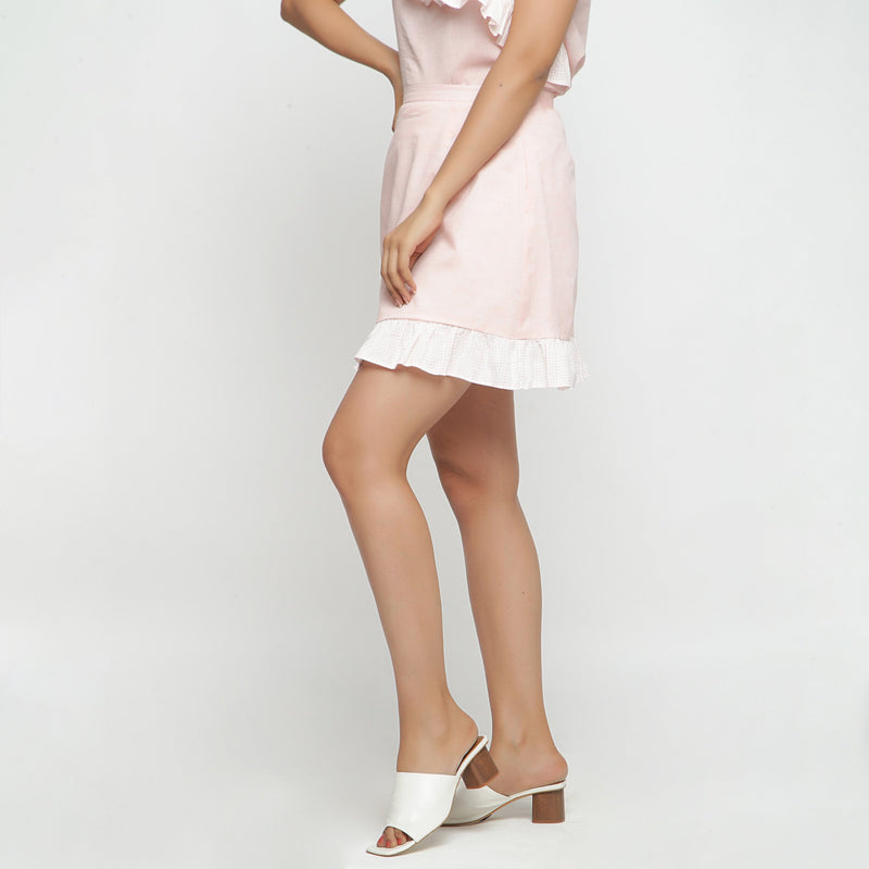 Left View of a Model wearing Peach Cotton Chambray A-Line Skirt
