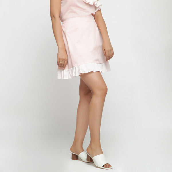 Right View of a Model wearing Peach Cotton Chambray A-Line Skirt