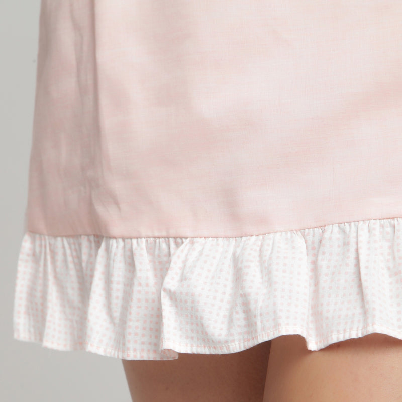 Close  View of a Model wearing Peach Cotton Chambray A-Line Skirt