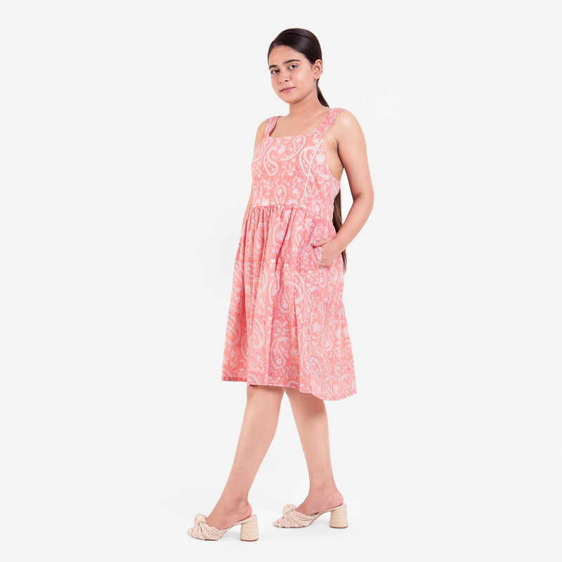 Left View of a Model wearing Peach Paisley Fit-and-Flare Cotton Dress