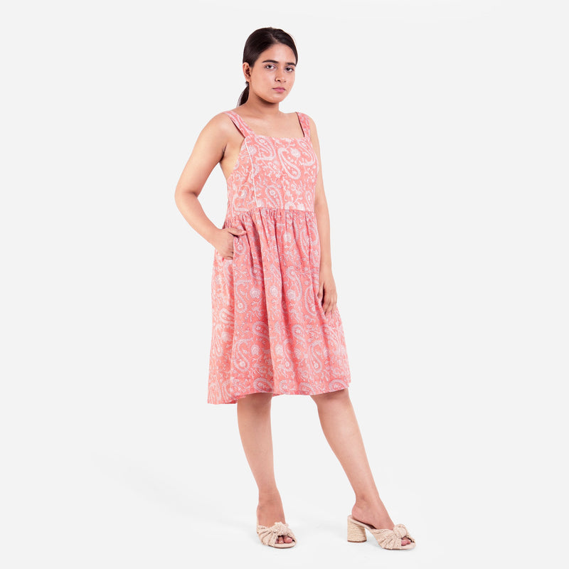 Right View of a Model wearing Peach Paisley Fit-and-Flare Cotton Dress