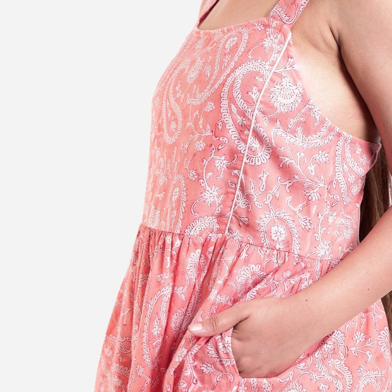 Left Detail of a Model wearing Peach Paisley Fit-and-Flare Dress