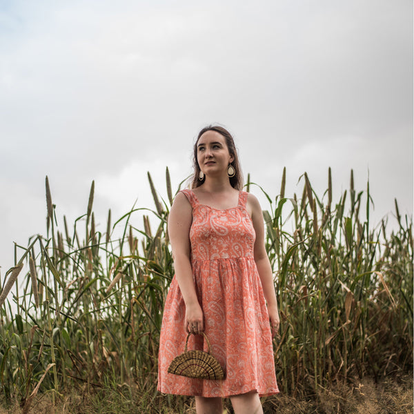 Front View of a Model wearing Peach Paisley Fit and Flare Cotton Dress