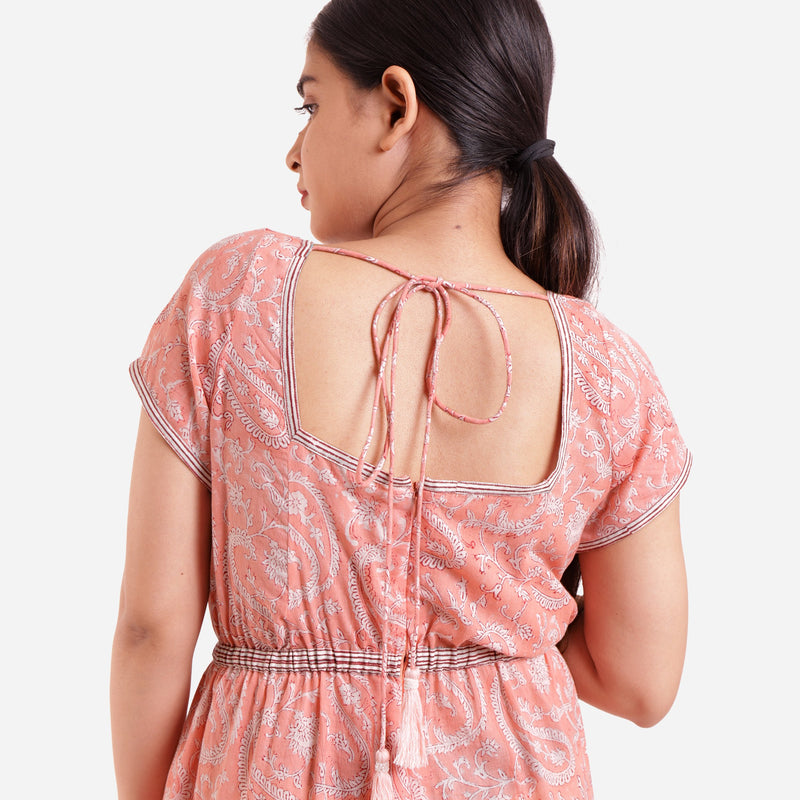 Back Detail of a Model wearing Peach Square Neck High Rise Jumpsuit