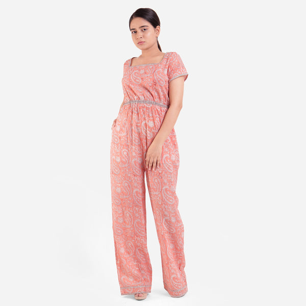 Front View of a Model wearing Peach Square Neck High Rise Jumpsuit
