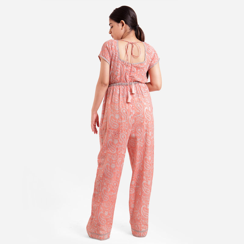 Back View of a Model wearing Peach Square Neck High Rise Jumpsuit