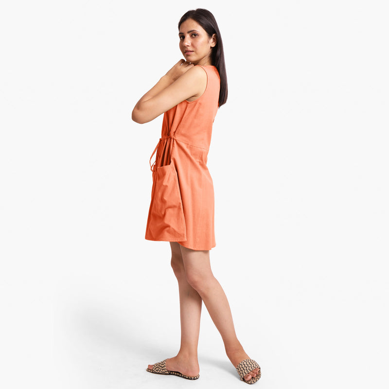 Left View of a Model wearing Peach Patch Pocket Round Neck Dress