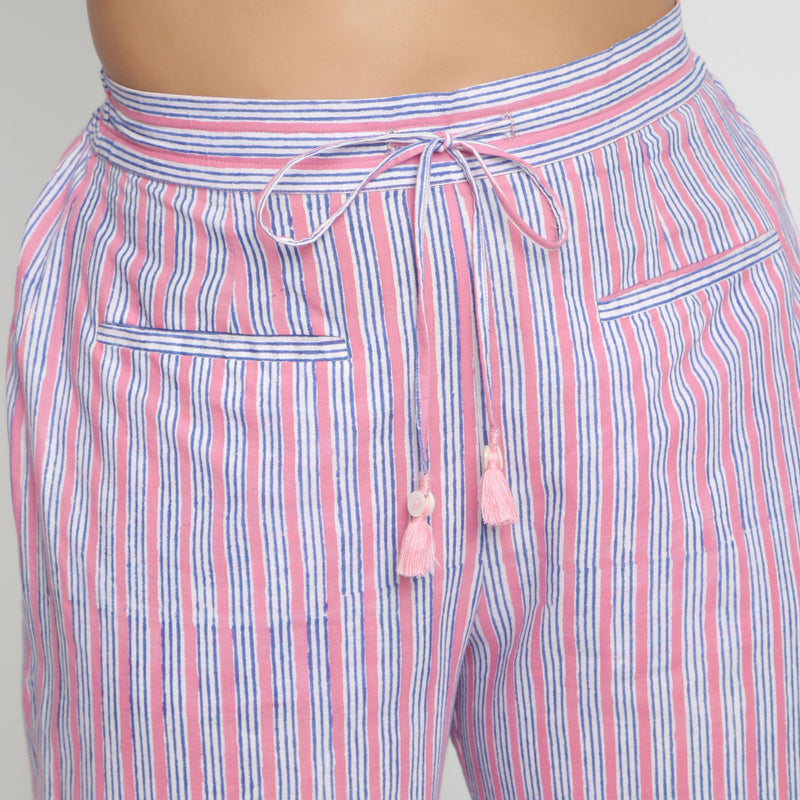 Front Detail of a Model wearing Pink and Blue Block Printed Cotton Pant