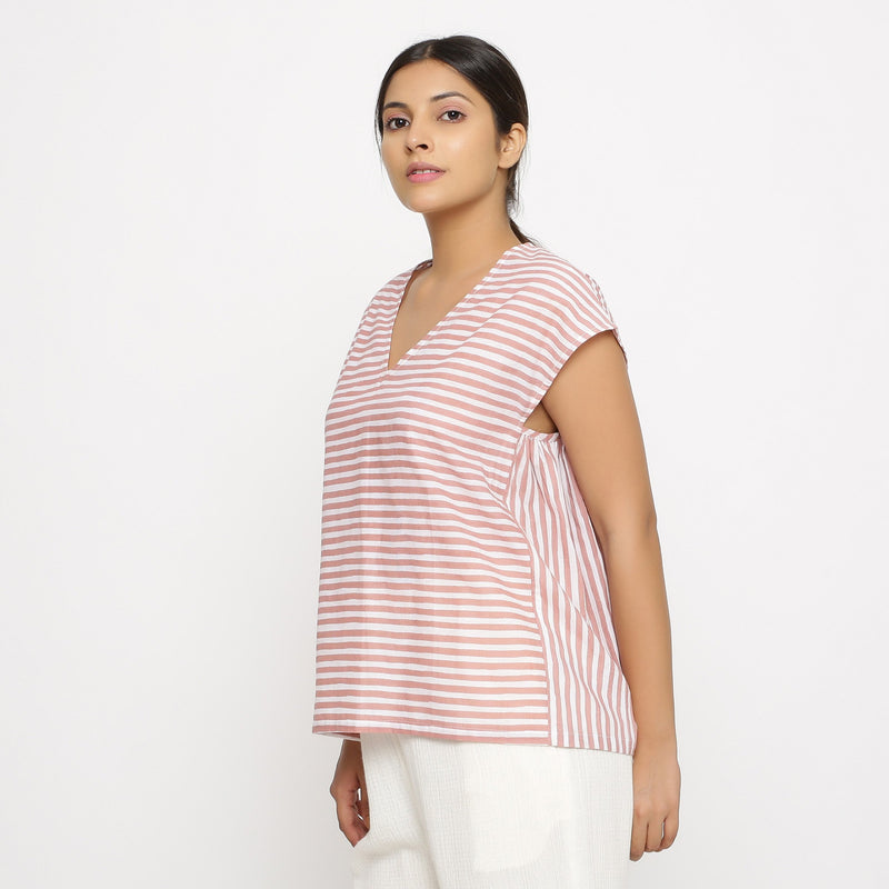 Left View of a Model wearing Pink And White Hand Screen Print Gathered Top