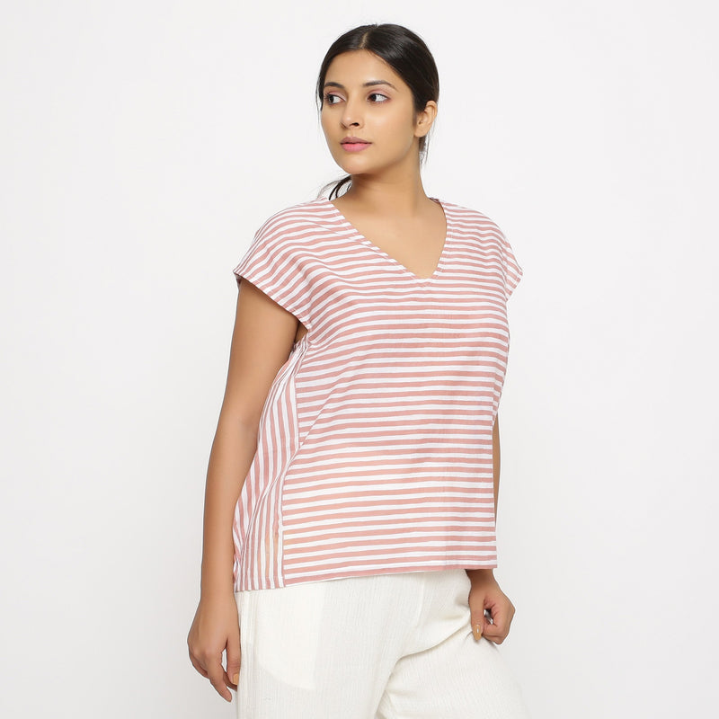 Right View of a Model wearing Pink And White Hand Screen Print Gathered Top