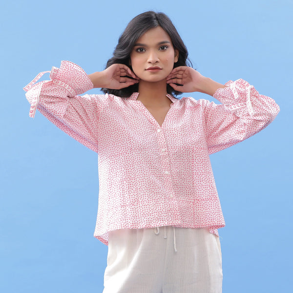 Front View of a Model wearing Pink Hand Block Printed Button-Down Blouse
