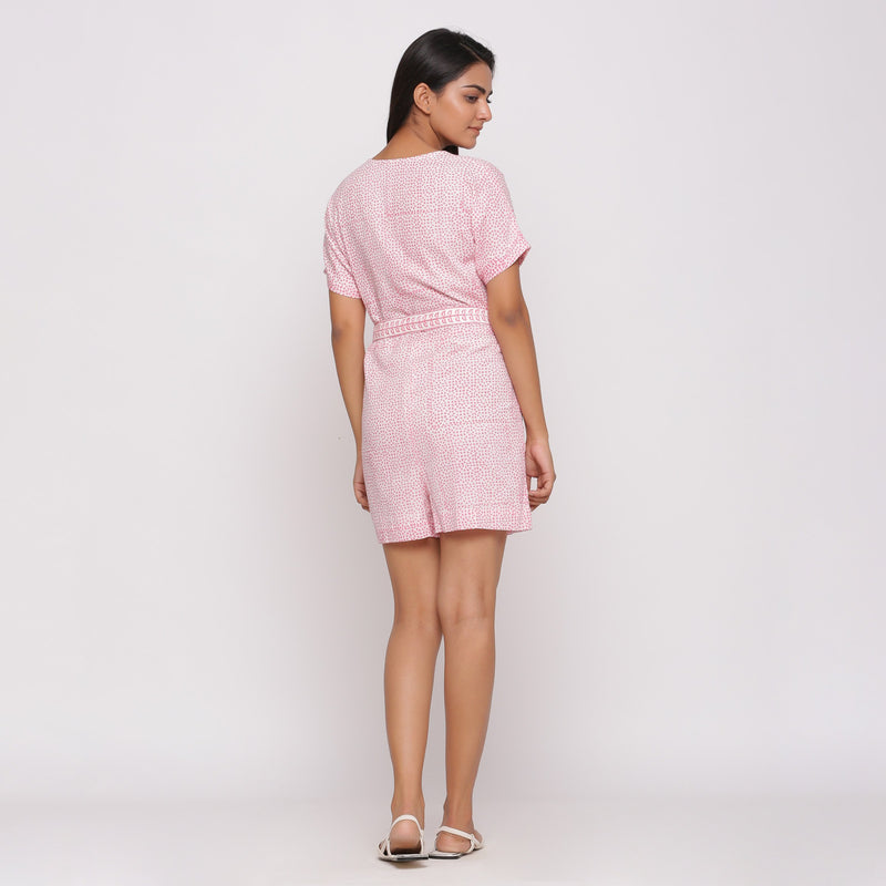 Back View of a Model wearing Pink Button-Down Short V-Neck Romper