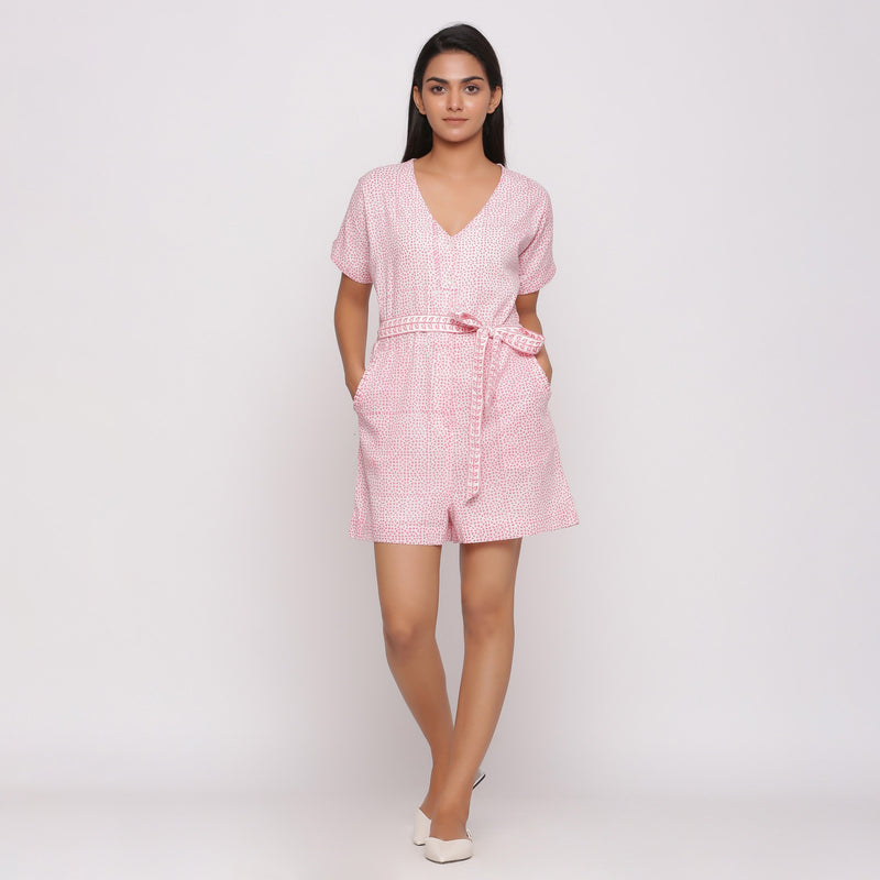 Front View of a Model wearing Pink Button-Down Short V-Neck Romper