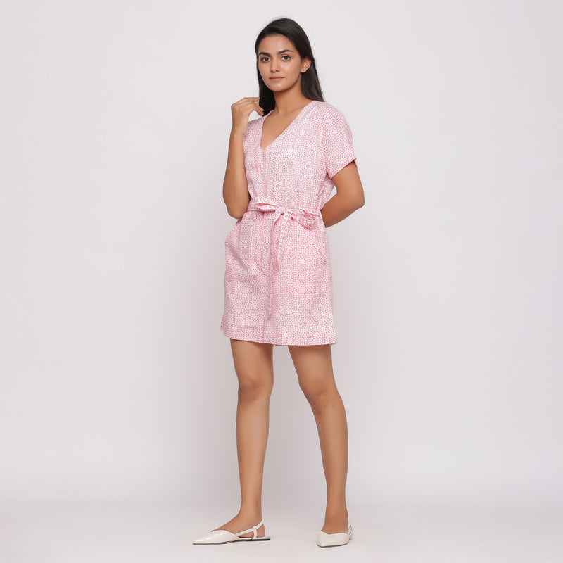 Left View of a Model wearing Pink Button-Down Short V-Neck Romper