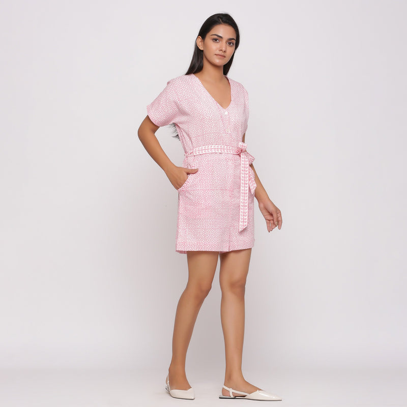 Right View of a Model wearing Pink Button-Down Short V-Neck Romper