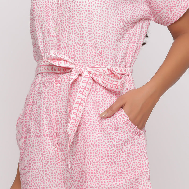 Front Detail of a Model wearing Pink Button-Down Short V-Neck Romper