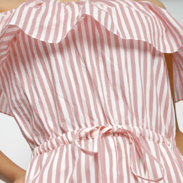 Front Detail of a Model wearing Pink Hand-Screen Print Playsuit