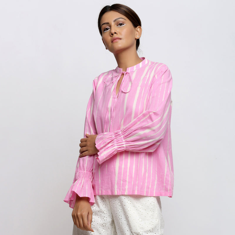 Left View of a Model wearing Pink Hand Tie Dyed Shirred Blouson Top