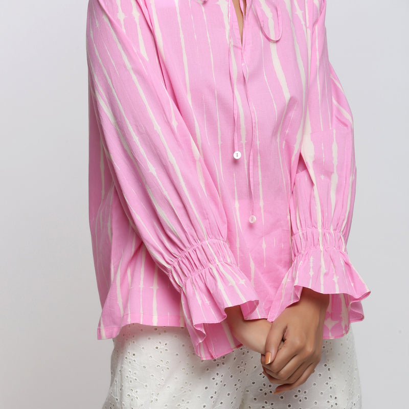 Close View of a Model wearing Pink Hand Tie Dyed Shirred Blouson Top