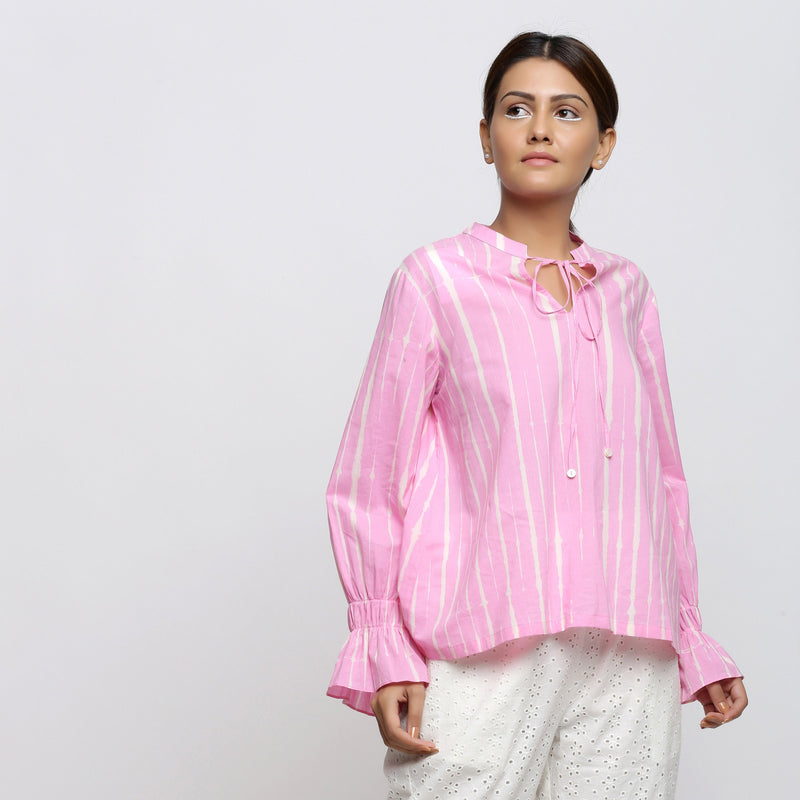 Right View of a Model wearing Pink Hand Tie Dyed Shirred Blouson Top