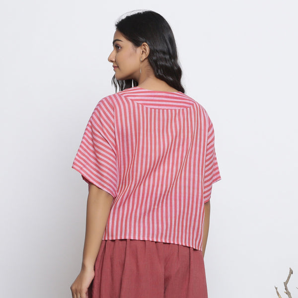 Back View of a Model wearing Pink Handspun Yoked Anti-Fit Top