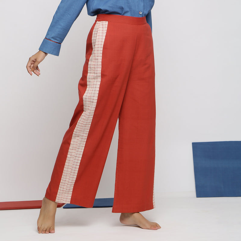 Right View of a Model wearing Brick Red Vegetable Dyed Wide Legged Pant