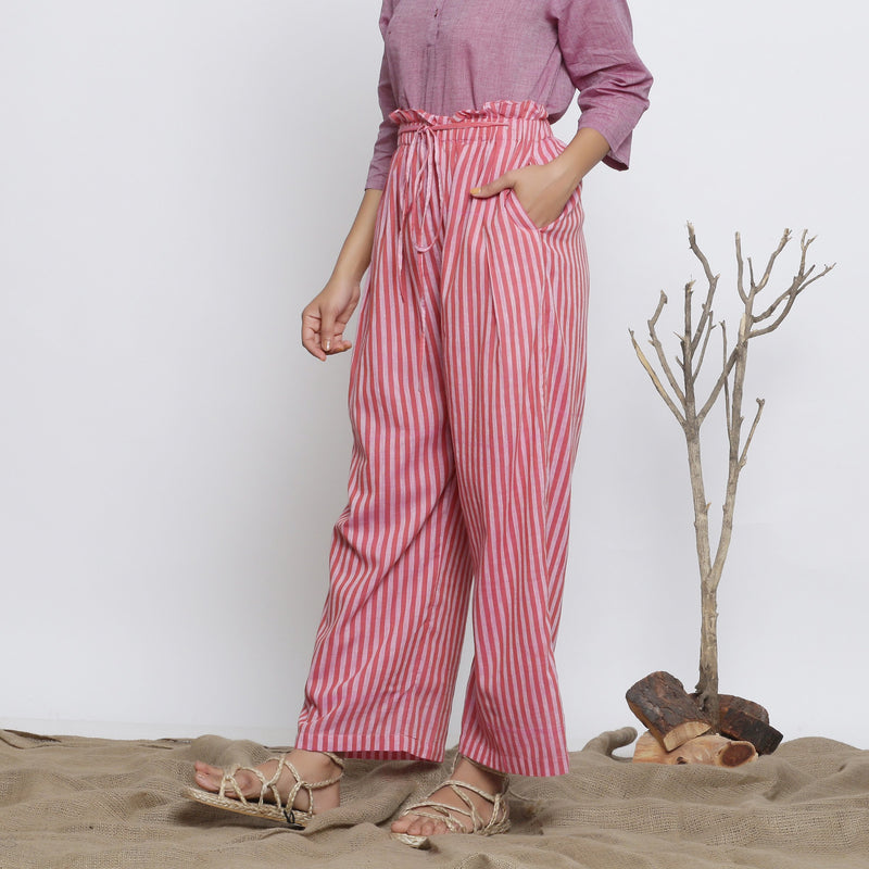 Left View of a Model wearing Pink Handspun Striped Paperbag Pant