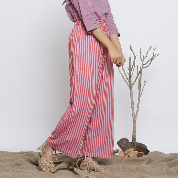 Right View of a Model wearing Pink Handspun Striped Paperbag Pant