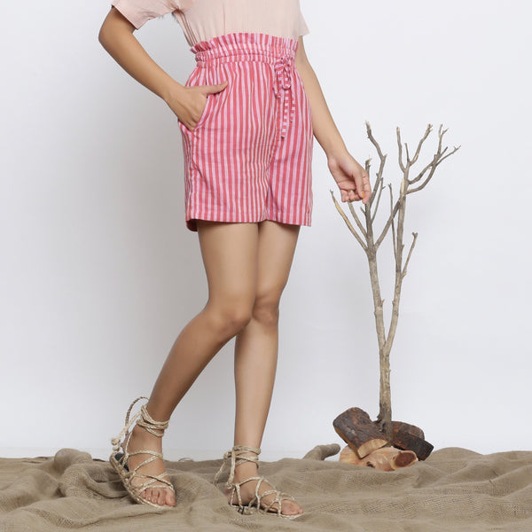 Right View of a Model wearing Pink Striped Handspun Paperbag Shorts