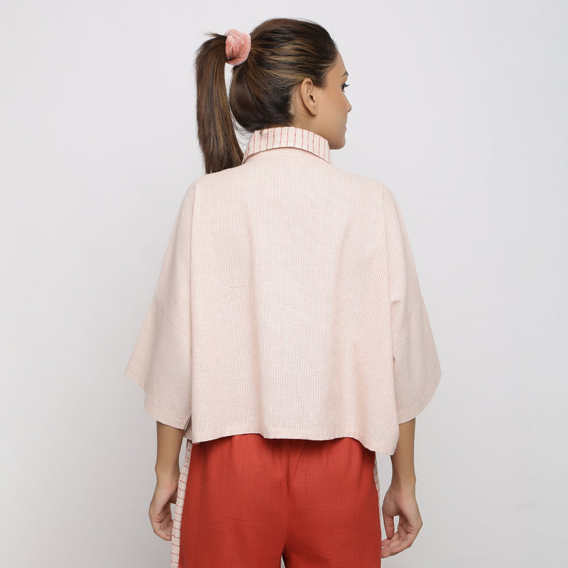Back View of a Model wearing Pink Handspun Vegetable Dyed Crop Top